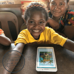 PNG girl looking at books on a tablet device